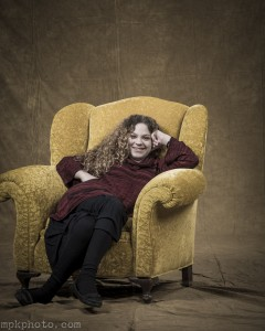 young lady in a chair